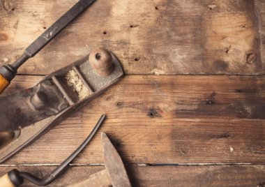 Od vintage hand tools on wooden background. Carpenter workplace.