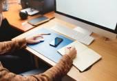 Fotografie Freelance developer and designer working at home, man writing in