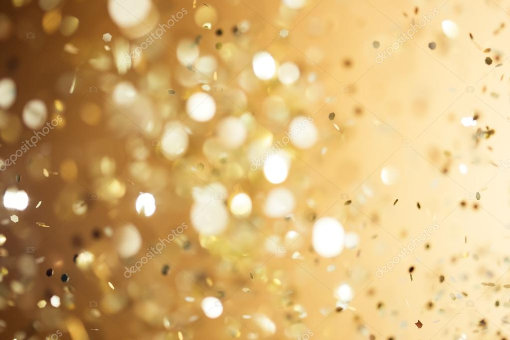 Christmas gold background. Golden holiday glowing abstract glitt