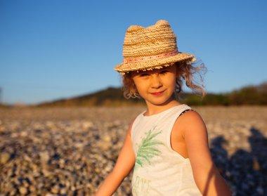 Cute little girl emotional outdoor portrait in warm light of sun