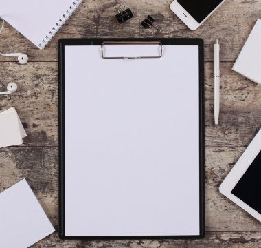 Blank white paper sheet in a clip folder