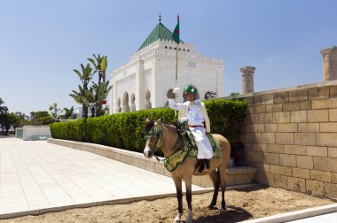 Royal guard in front of the Hassan Tower and Mausoleum of Mohammed V