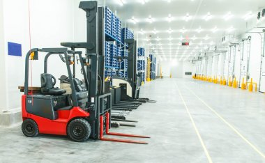 Large warehouse with forklifts