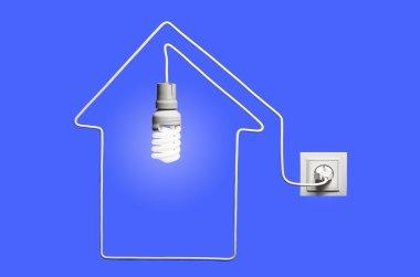 Glowing lightbulb in a house
