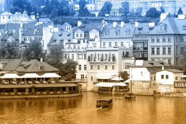 Two-color postcard with view of Prague