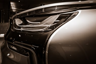 BERLIN - NOVEMBER 28, 2014: Showroom. The rear lights of the car BMW i8, first introduced as the BMW Concept Vision Efficient Dynamics, is a plug-in hybrid sports car developed by BMW. Toning
