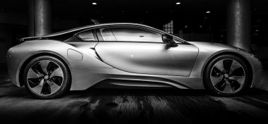 BERLIN - NOVEMBER 28, 2014: Showroom. The BMW i8, first introduced as the BMW Concept Vision Efficient Dynamics, is a plug-in hybrid sports car developed by BMW. Black and white.