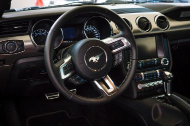 The cockpit of a pony car Ford Mustang 50th Anniversary Edition, 2015. The Classic Days on Kurfuerstendamm.