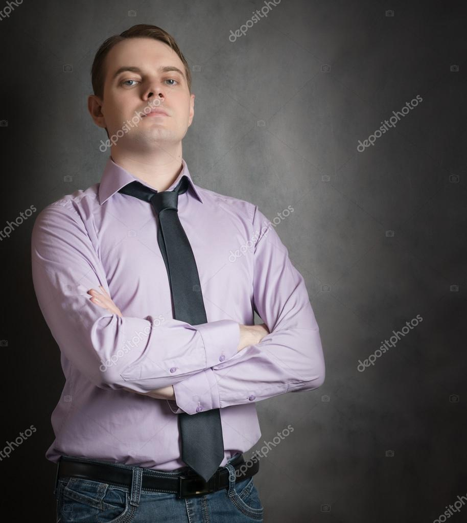 6be5a9db Portrait of young man in pink shirt. — Stock Photo © eevl #104656404