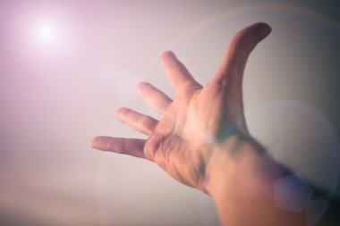 Hand reaching to sky.