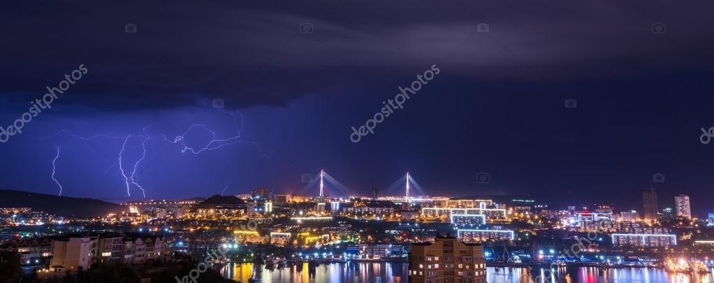 Lightning over city.