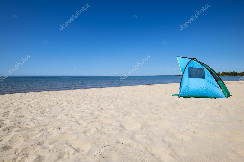 Colorful Solar Shade on the Beach u2014 Photo by chiyacat & Tent on the Beach u2014 Stock Photo © chiyacat #122561914