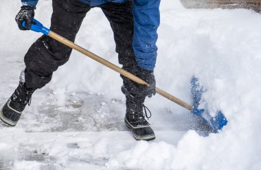 Man Removing Snow with a Shovel