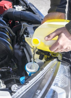 Filling Up Windshield Washer Fluid in a Car