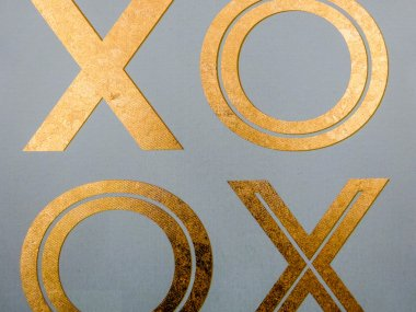 golden xoxo letters on canvas board