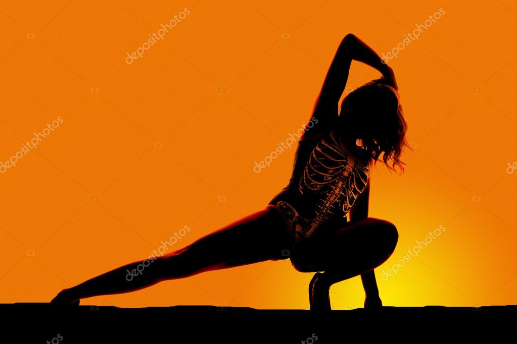 silhouette of skeleton woman squat leg out