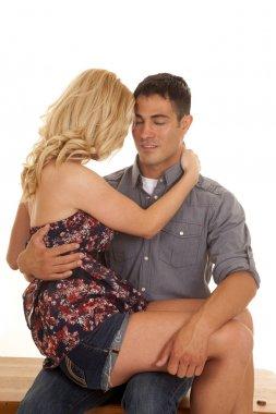 woman on mans lap eyes closed