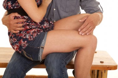 woman sit on mans lap close legs