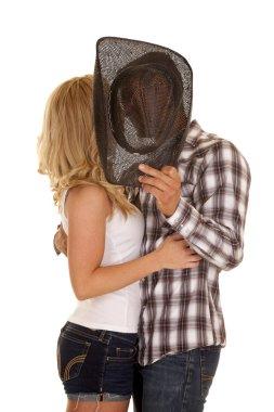Cowboy couple behind hat