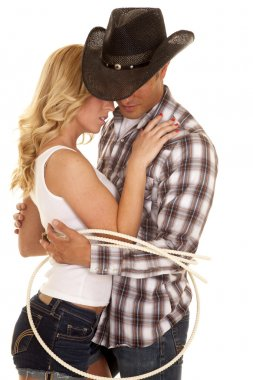 Cowboy and his girl tied up together