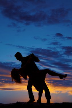Silhouettes of couple dancing
