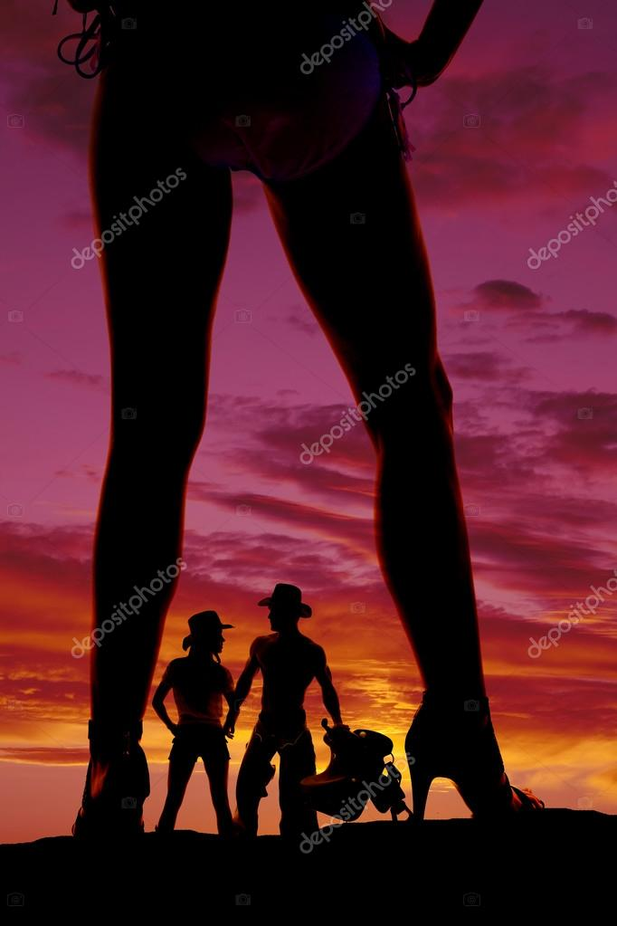 Silhouette woman with couple between legs