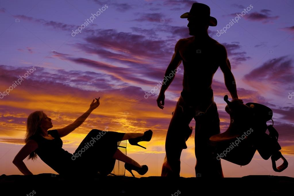Silhouette woman and cowboy