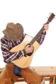 Photo cowboy play guitar head down