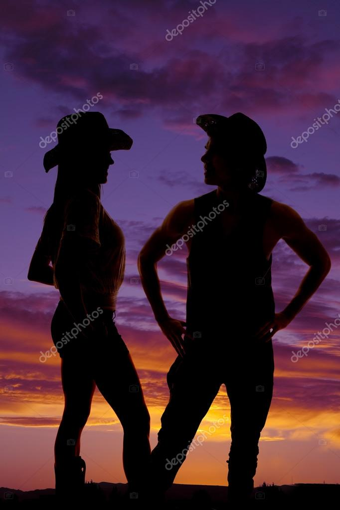 Silhouette of cowboy and cowgirl