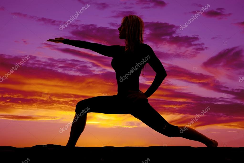 Silhouette woman doing yoga