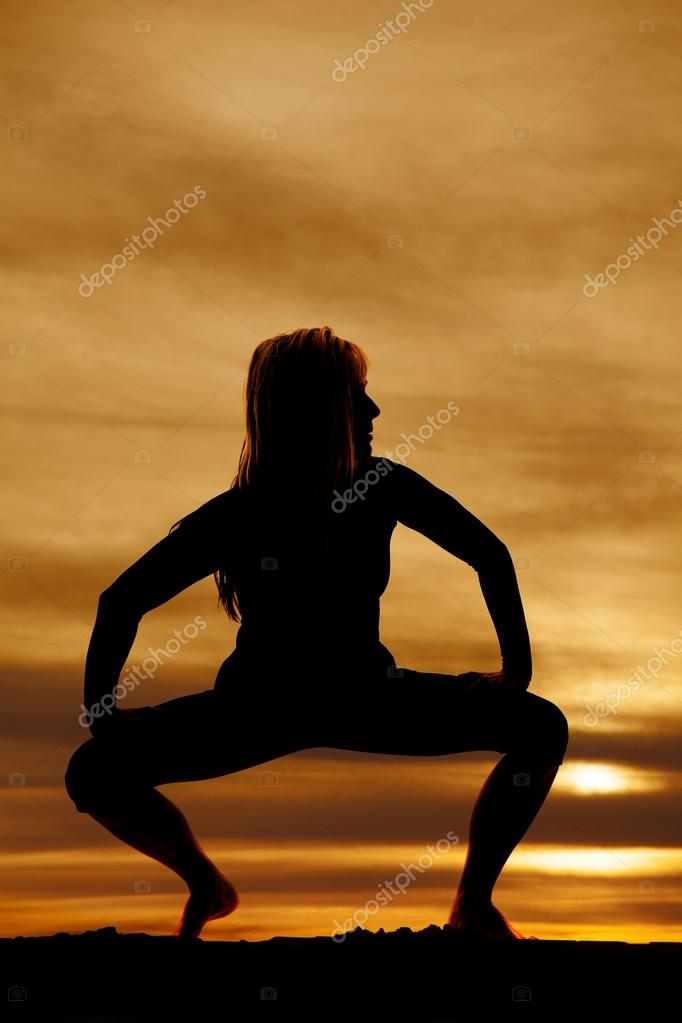 Silhouette woman doing yoga pose.
