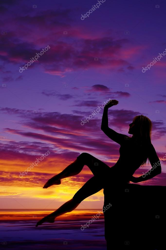 Silhouette woman.Posing on beach background