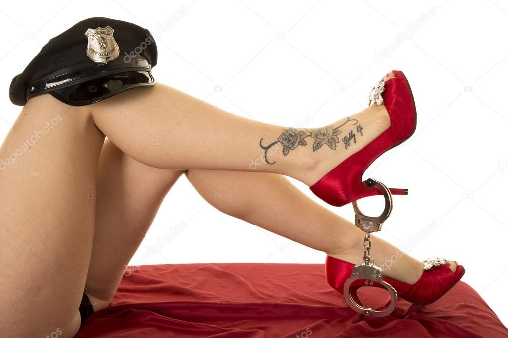 Woman legs with tattoo