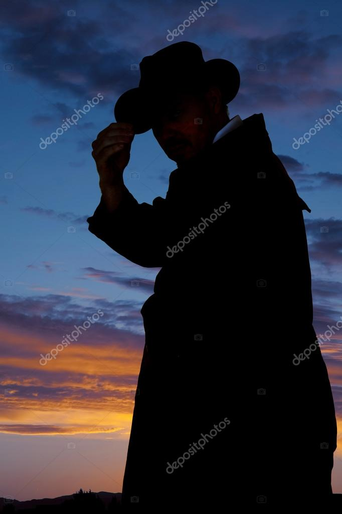 Silhouette of cowboy on sunset