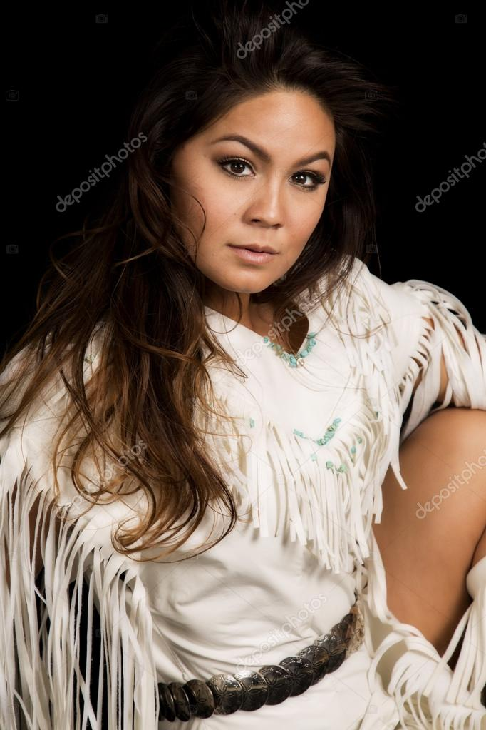 Native American woman in white outfit