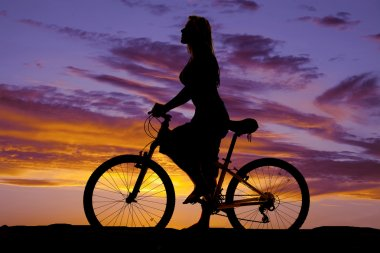 Silhouette of a woman on a bike