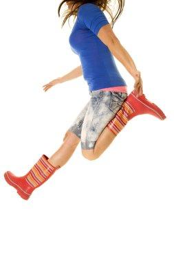 woman jump body in rain boots