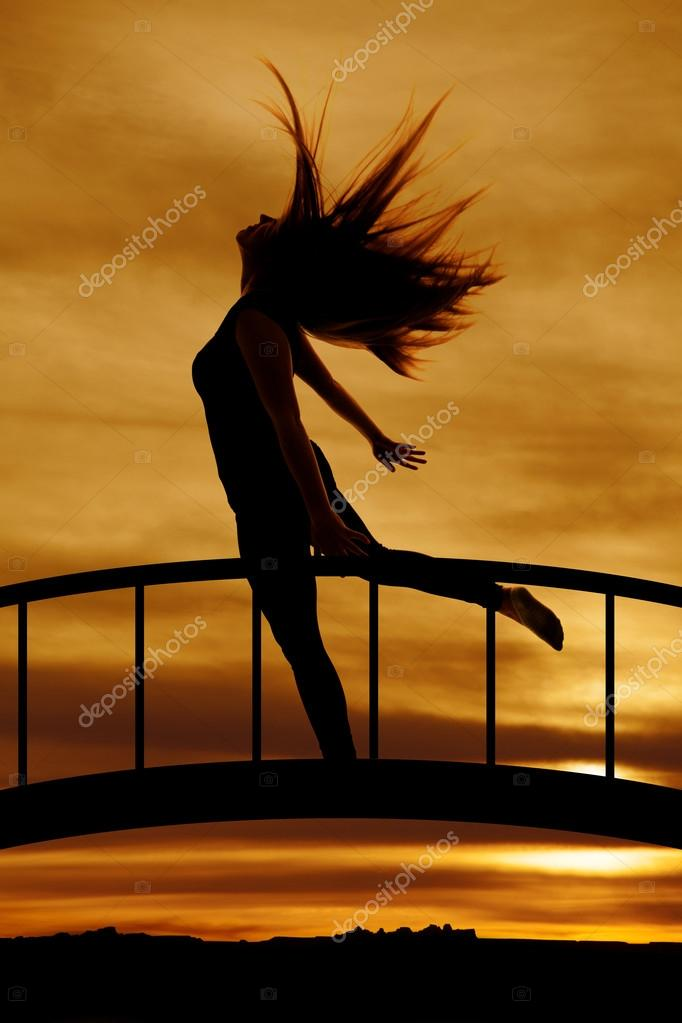 Silhouette of jumping woman