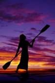 Silhouette of  woman with paddle