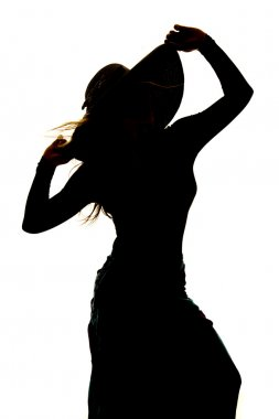 Silhouette of  woman in  skirt
