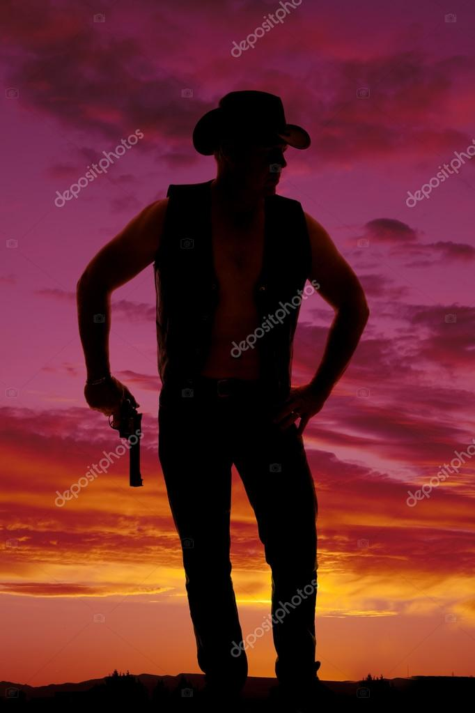 silhouette of cowboy with pistol