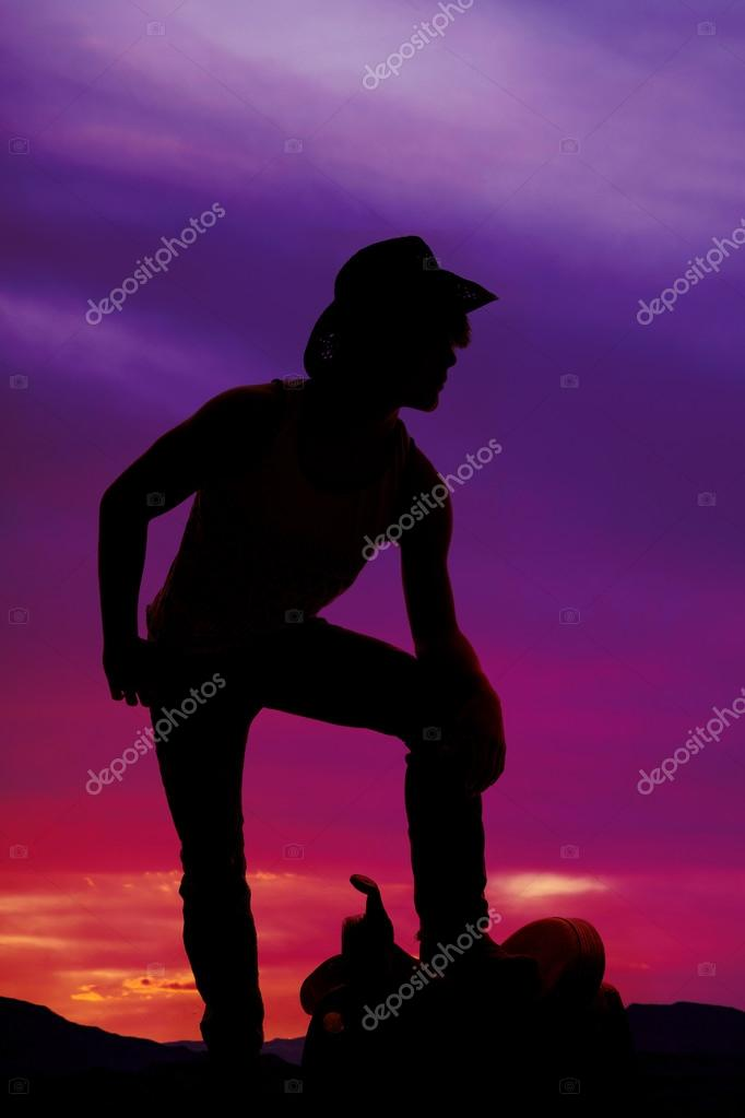 silhouette of a cowboy outdoors