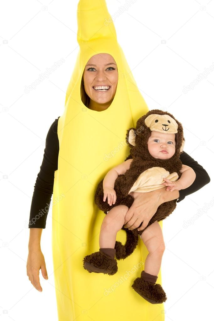 A mom in her banana costume with a smile holding on to her little baby in her monkey costume. u2014 Photo by alanpoulson  sc 1 st  Depositphotos & mom in banana costume with monkey baby u2014 Stock Photo © alanpoulson ...