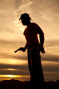 silhouette of cowboy man