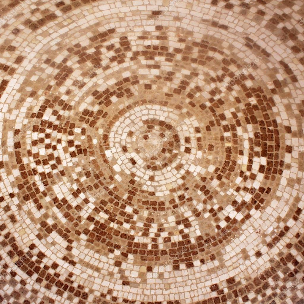 Old roman beige and brown mosaic ceramic tiles in circle pattern old roman beige and brown mosaic ceramic tiles in circle pattern stock photo dailygadgetfo Images