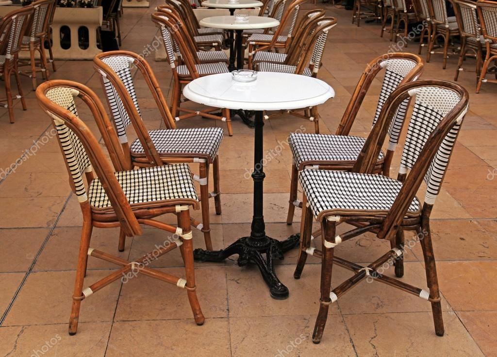 French Outdoor Cafe With Small Round Tables And Chairs Stock Photo C Felker 70193499