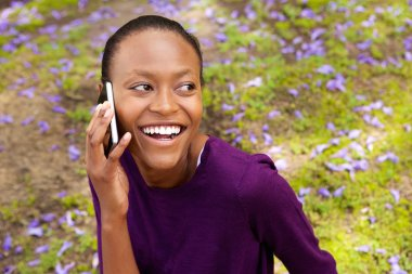 Beautiful young african woman using cell phone
