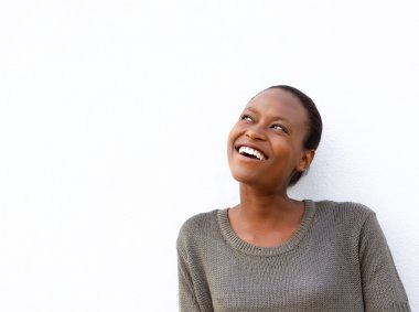 Close up portrait of smiling young african woman looking away at copy space against white background stock vector
