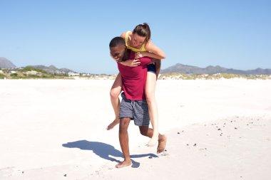 Carefree couple enjoying on the beach