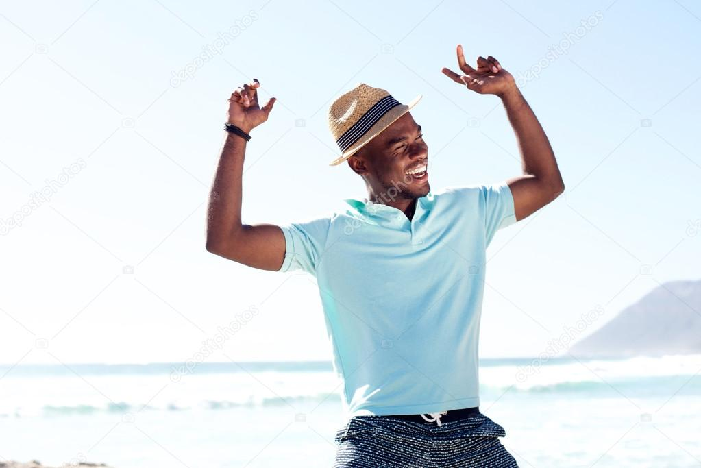 Young african man having fun at the beach